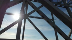 Travel on the metal bridge. Metal structures flashed against the sky. Stock Footage