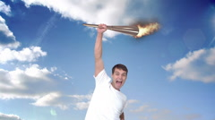 Montage of triumphing athlete holding Olympic torch over head Stock Footage