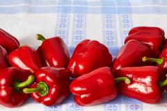 Scattering of red pepper on a towel. Stock Photos