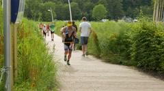 Ostseeman 2015 In Gluecksburg, Germany - marathon runners run past Stock Footage