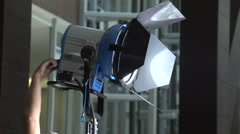 Hand tuning lighting fixture Stock Footage
