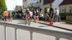 Ostseeman 2015 In Gluecksburg, Germany - Triathletes reach the hill crest Stock Footage