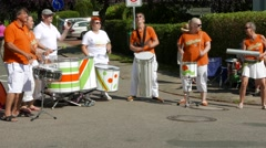 Ostseeman 2015 In Gluecksburg, Germany -  Samba group plays roadside - stock footage