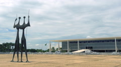 Dois Candangos Monument and Planalto Palace in Brasilia, Capital of Brazil Stock Footage