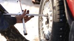 Worker untwists wheel Stock Footage