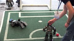 Entertainment mobile Robots playing soccer at the VII International IT Forum. Stock Footage