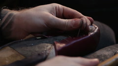 Shoemaker sews shoes. Hammering shoe leather - stock footage