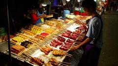 Thailand Satay Street food table night Stock Footage