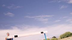 Sportswoman practicing hurdle race Stock Footage