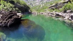 AERIAL: Beautiful blue mountain river running through rocky valley in Serbia - stock footage