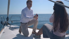Enamored couple sitting on a yacht Stock Footage
