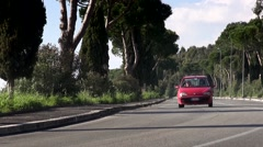 Italian Red Car Passing on Countryside Road Stock Footage