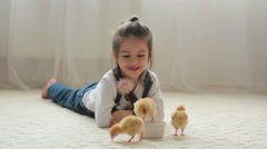 Young beautiful girl, playing with little newborn chick at home - stock footage