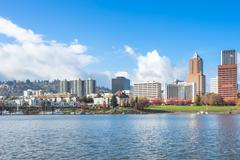 Tranquil water with cityscape and skyline of portland Stock Photos
