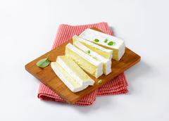 Carré de l'Est - French cow's milk cheese with white rind - stock photo