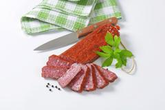 Hunter's salami - hard salami containing pork and beef, seasoned with pepper - stock photo