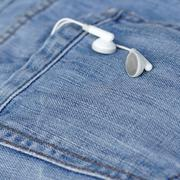 White earbuds in back pocket jeans Stock Photos