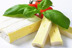 Brique cheese - soft cow's milk cheese with thin edible rind Stock Photos