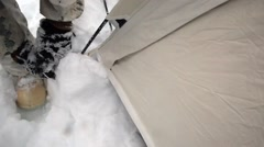 Norway, March 2016, Detail Shot Two Soldiers Fix Tent Snow - stock footage