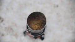 Norway, March 2016, Pot With Cooking Water On Burner Snow - stock footage