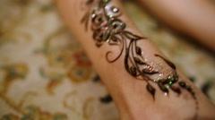 Mehndi. Henna pattern on model's foot Stock Footage
