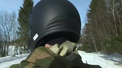 Norway, March 2016, Soldier Drive On Ski Doo Through Snowy Area Stock Footage