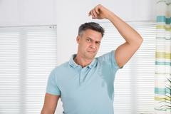 Man With Hyperhidrosis Sweating Very Badly Under Armpit At Home Stock Photos