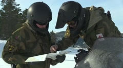 Norway, March 2016, Close Up Two Soldiers Check Map Winter Area Ski Doo - stock footage