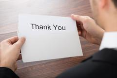Close-up Of Businessman Holding Thank You Card In Envelope Stock Photos