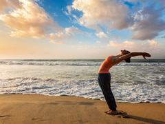 Woman doing yoga Sun salutation Surya Namaskar Stock Photos