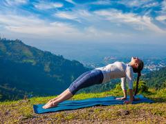 Woman doing Hatha yoga asana Purvottanasana Stock Photos