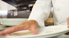 Chef tidying up the plates - stock footage