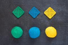 Balls of yarn and crocheted motives Stock Photos