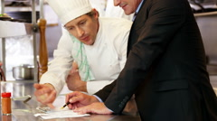 Chef talking with employer - stock footage