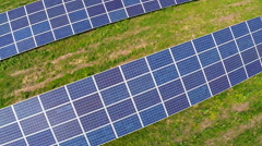 Aerial flight over blue solar panels Stock Footage