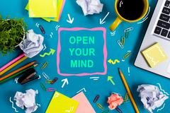 Open your mind. Office table desk with supplies, white blank note pad, cup, pen Stock Photos