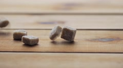 Close up of brown sugar on wooden board or table Stock Footage