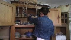 Woman choosing a ceraminc dish Stock Footage