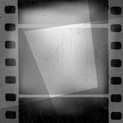 Stock Illustration of Grunge monochrome filmstrip with space for text . Film noir, old cinema backg