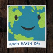 Photo frame with Earth snapshot closeup. Earth day concept. On wooden backgro Stock Illustration