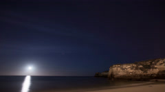 4k Night sky stars timelapse upcoming moon ocean cliffs fade out - stock footage