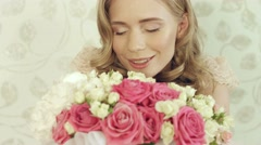 Enthusiastic girl posing with a big and beautiful bouquet of small roses Stock Footage
