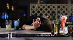 Bartender Cocktail submits for drunken women. Around the unfinished alcoholic Stock Footage