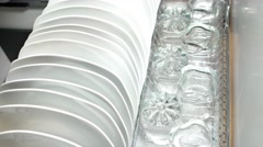 Beautiful white dishes and cups transparent Dolly Shot in a drawer. - stock footage