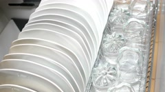 Beautiful white plates and transparent glasses. Stock Footage