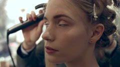 Make-up and hairstyle for the model before the show Stock Footage