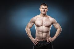 Sporty and healthy man isolated on dark blue background - stock photo
