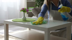 Young happy woman cleaning  the table close-up Stock Footage