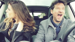 Beautiful woman moving very long hair in slow motion in car with boyfriend Stock Footage