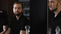 Professional bartenders, stylish black shirt. Work at a party at a nightclub Stock Footage